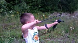 Ro shooting the wrist rocket at a target